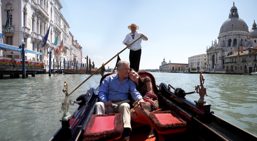 Man and woman in gondola in Venice