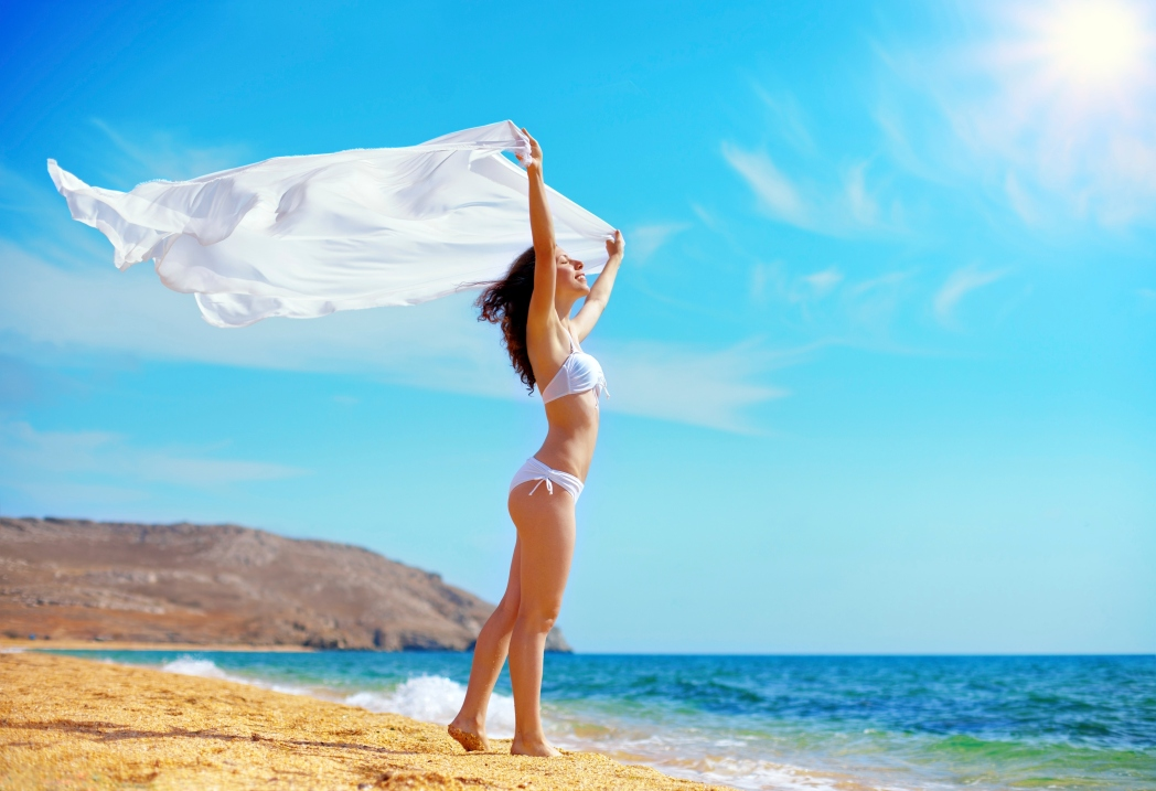 Lady with sarong on beach