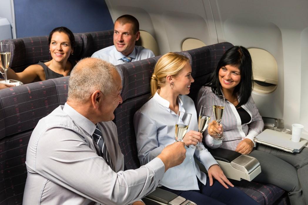 Passengers drinking champagne