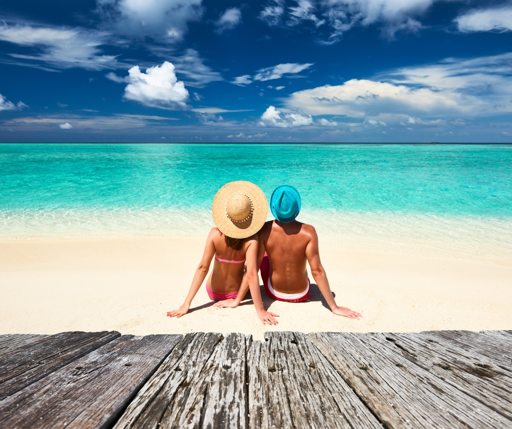 Man and woman sitting on a beach