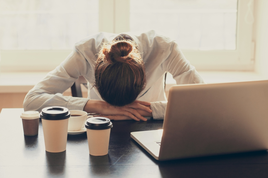 Woman stressed at work desk