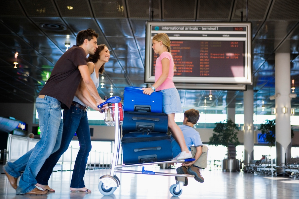 Airport travellers with luggage