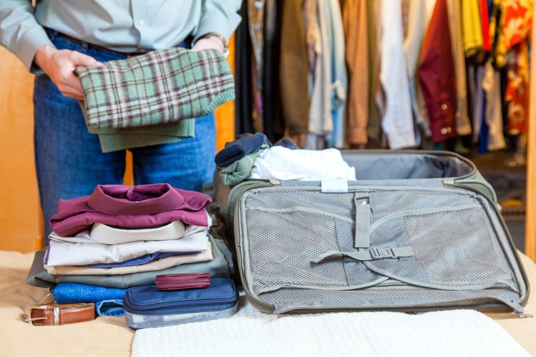 man folding clothes