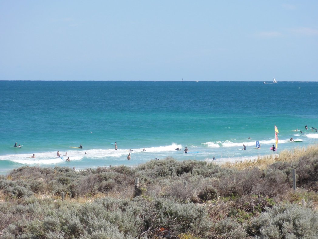 Surfers, lifesavers & cool dudes hang out at Trigg Beach where there is always surf